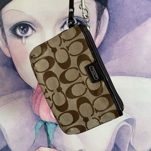 women's brown Coach wristlet